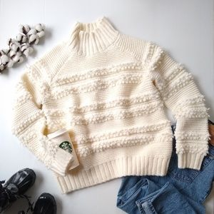 Magaschoni • chunky knit mockneck cream sweater